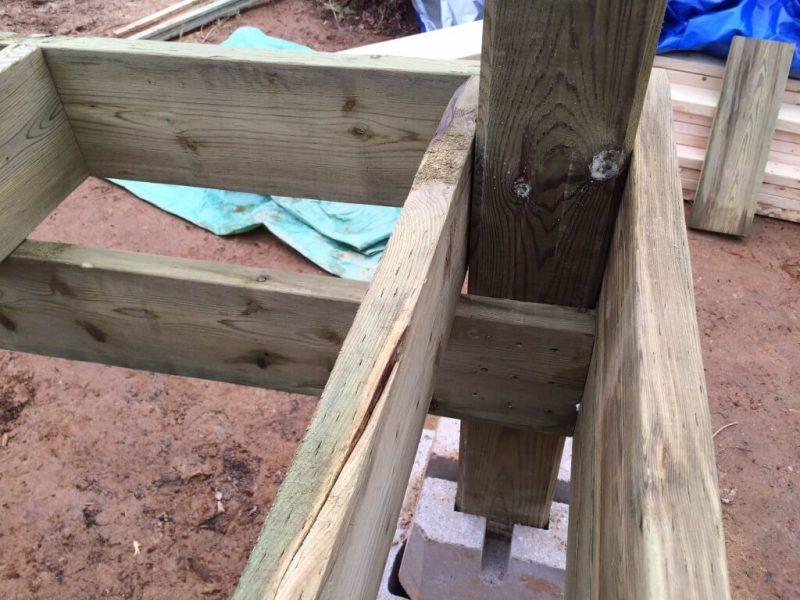 Cabin front deck subfloor framing post corner