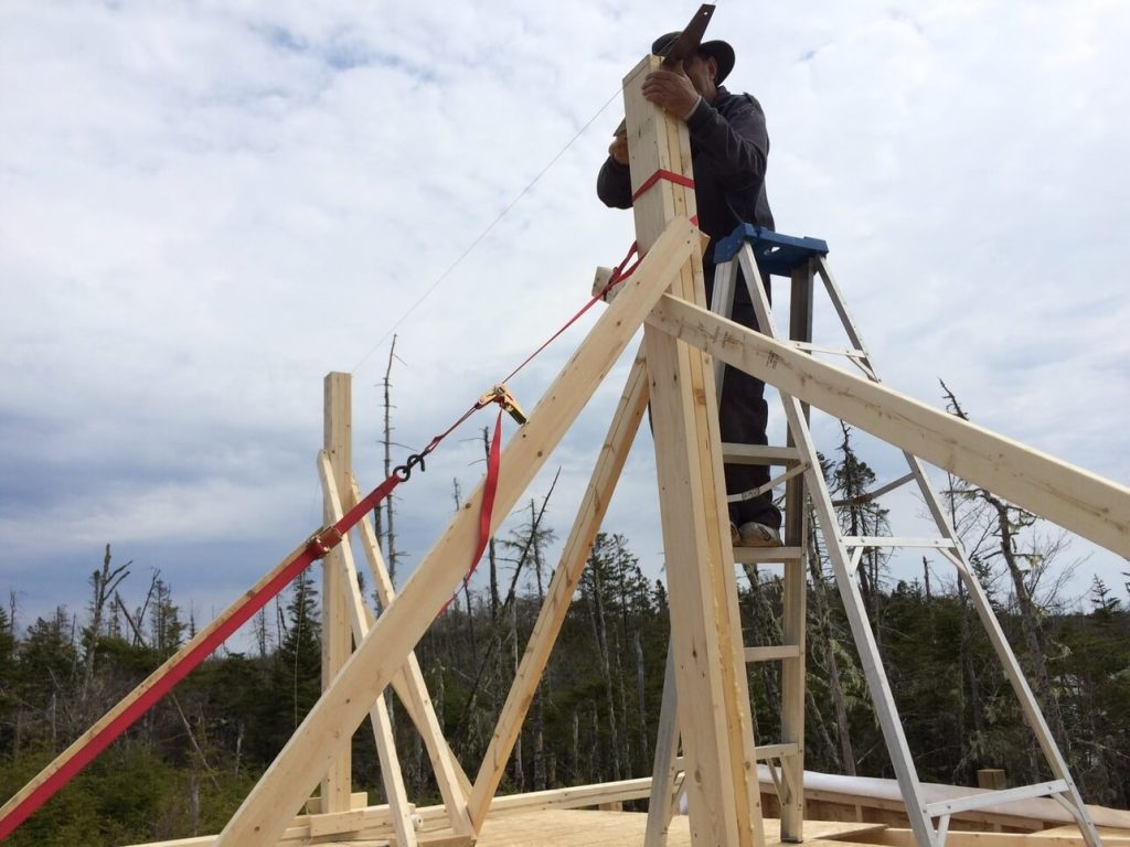 Trimming-The-Off-Grid-Cabin-Roof-Ridge-Beam-Post-2