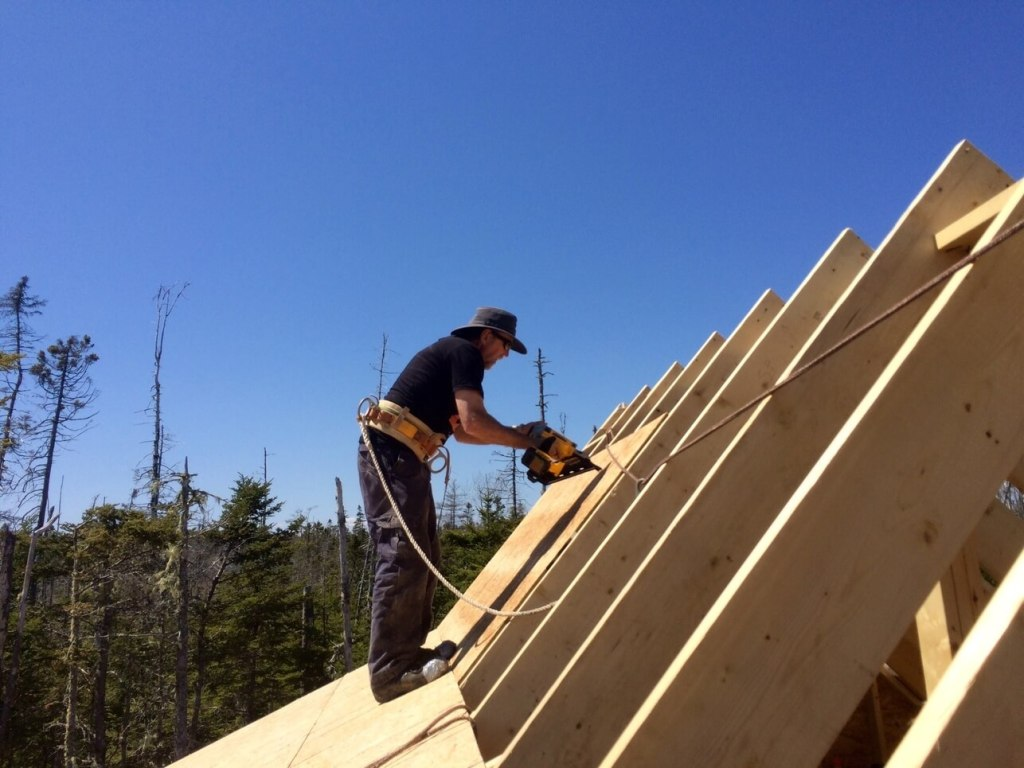 The-Off-Grid-Cabin-Roof-OSB-Sheathing-nailing-over-cabin