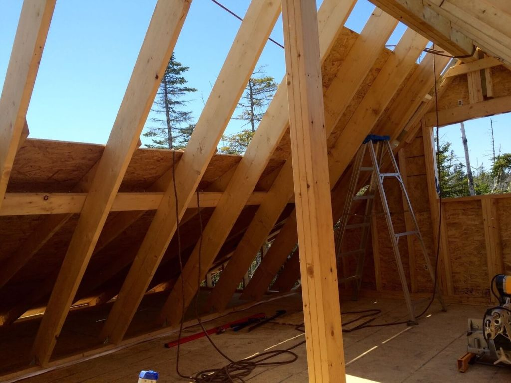 The-Off-Grid-Cabin-Roof-OSB-Sheathing-over-front-cabin-half-complete