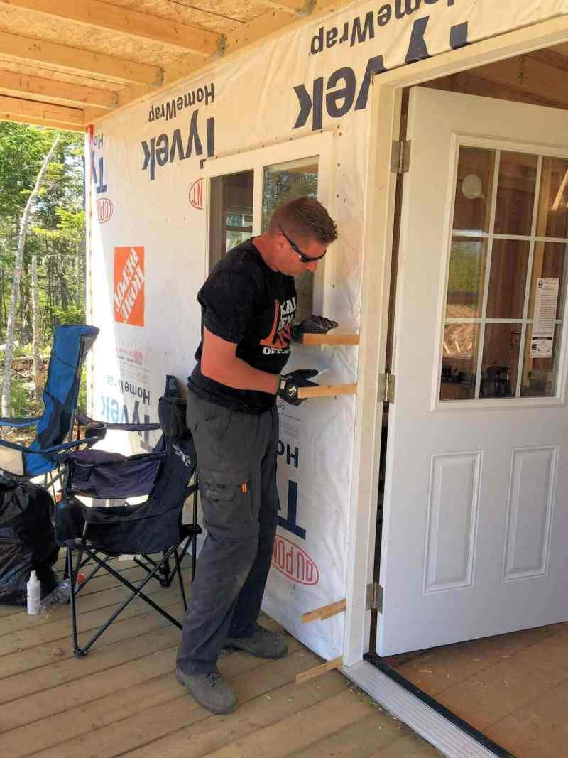 Shimming-The-Off-Grid-Cabin-Front-Door