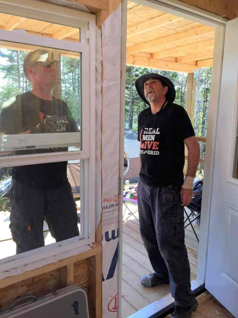 The-Off-Grid-Cabin-Front-door-install-complete