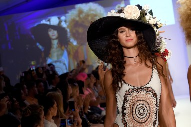 MIAMI, FL - JULY 17: A model walks the runway at Baes and Bikinis 2017 Collection during SwimMiami at The W Hotel South Beach on July 17, 2016 in Miami, Florida. (Photo by Frazer Harrison/Getty Images for Baes And Bikinis)