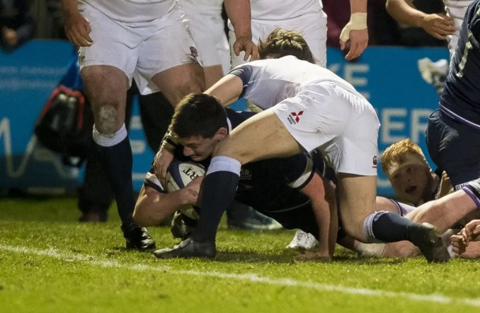 Ewan Johnson stretches for the line to score Scotland's opening try.