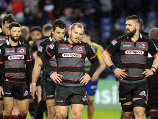 Edinburgh players leave the field