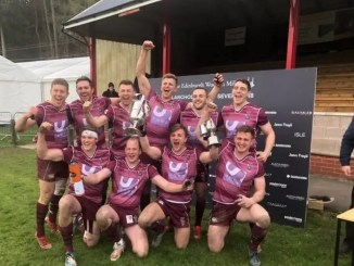 The Watsonians squad celebrate their victory at Langholm on Saturday