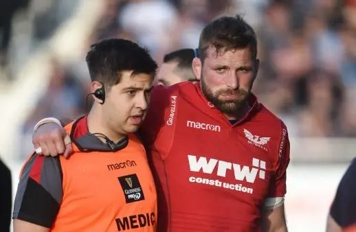 John Barclay is helped from the field after injuring his Achilles Tendon whilst playing for the Scarlets in Friday night's victory over Glasgow Warriors