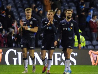 Huw Jones, Finn Russell and Alex Dunbar leave the field at the end of the match.