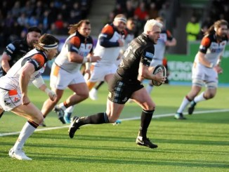 Stuart Hogg breaks through the Edinburgh defence.