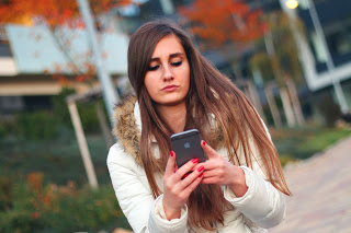 Young woman looking a smart phone. @ http://theolddirtroad.com
