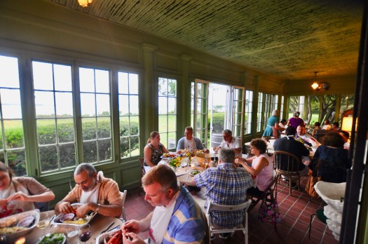 Our Wine Club members enjoying a lobster dinner in an enclosed porch.