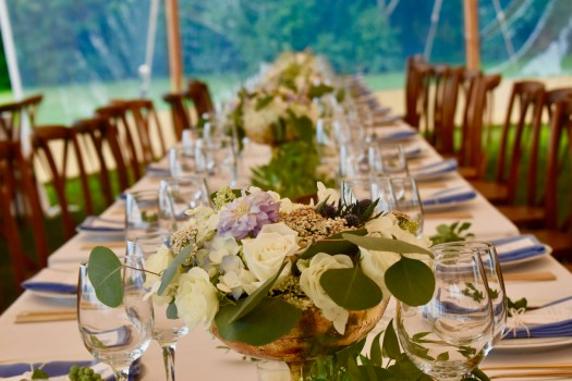 flower arrangements at set table
