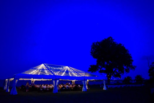 Clear top tent at night with lights.