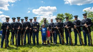 Soldiers with the 3d U.S. Infantry Regiment (The Old Guard) Fife and Drum Corps and The U.S. Army Drill Team pose with retired 1st Sgt. Charlie Barsdale and his grandsons, following a performance at Westridge Elementary School, in Woodbridge, Virginia, on June 9, 2017. The performance was part of the school's end of the year celebration, and one of the many community outreach activities the regiment conducts weekly. (U.S. Army photos by Nicholas T. Holmes)