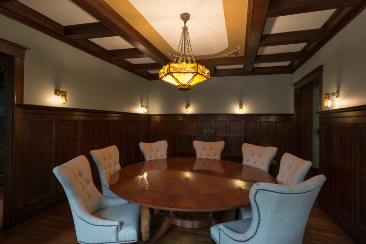 A old Tiffany Chandelier centered the oak paneled dining room in La Grange, il. We moved it and painted over the dated ceiling painting