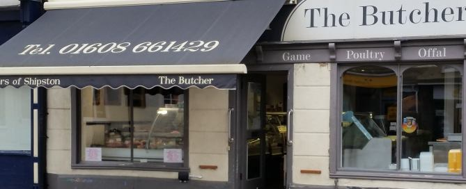 The photograph shows the exterior of Taylors of Shipston, a traditional butcher