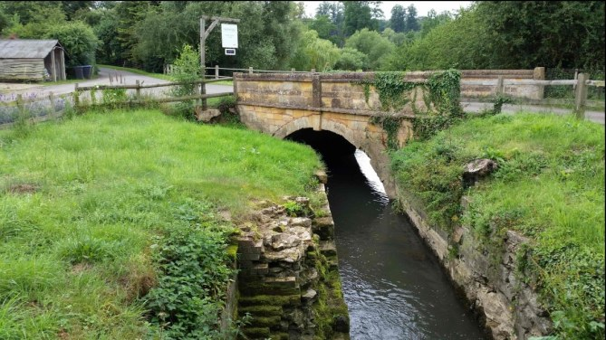 The stream and stone bridge at Talton Mill Farm Shop