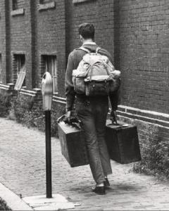 student with luggage