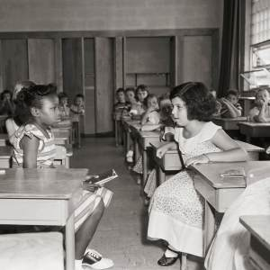 08 Sep 1954, Arlington, USA --- Two students in Fort Myer Elementary School face each other on the first day of desegregation. The school, operated by the military for the children of military personnel, was desegregated by order of the Defense Department. --- Image by © Bettmann/CORBIS