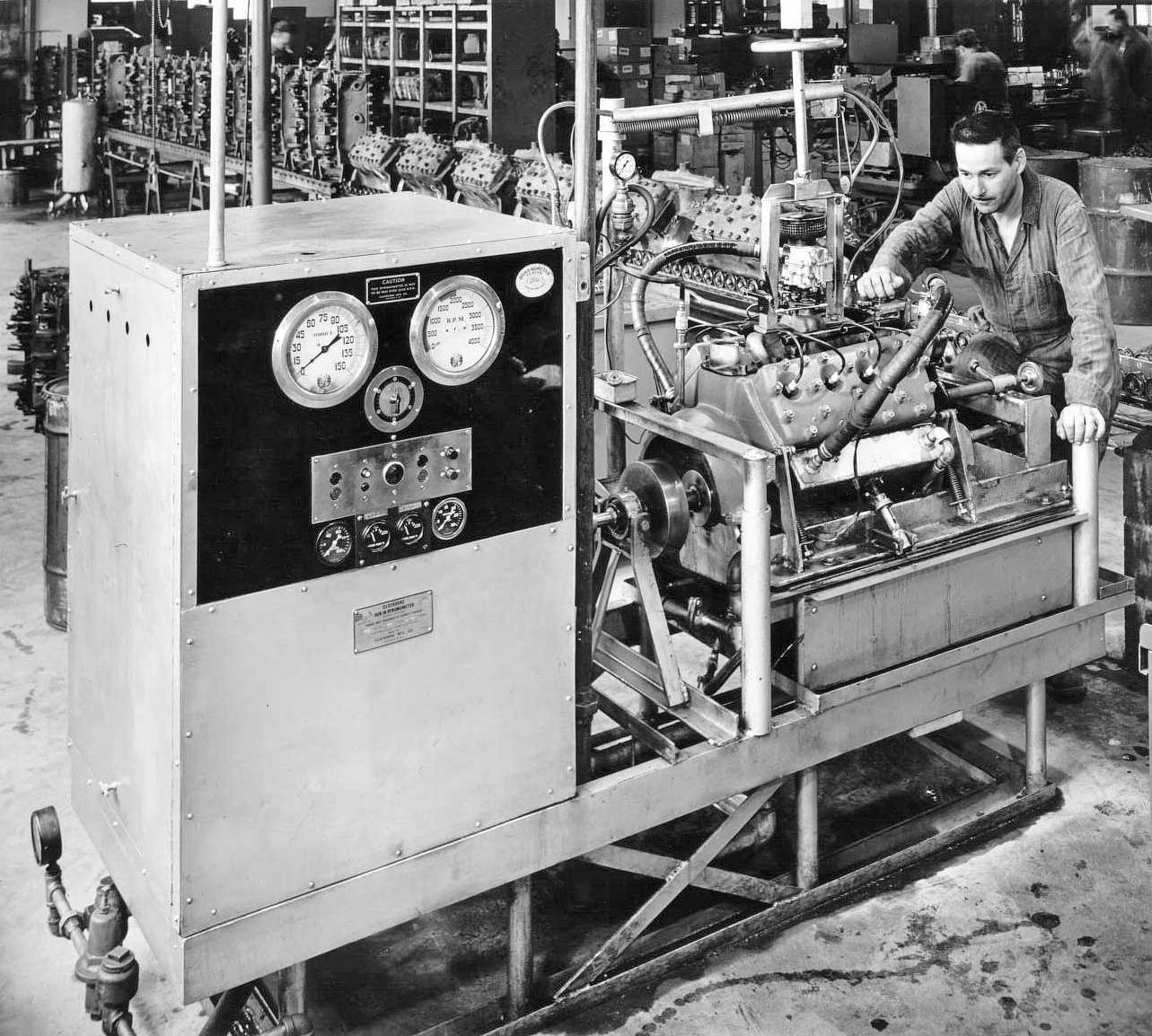 hight resolution of this machine is a dynamometer used for testing finished engines and its operator posing for the photo the exhaust pipes are not installed yet