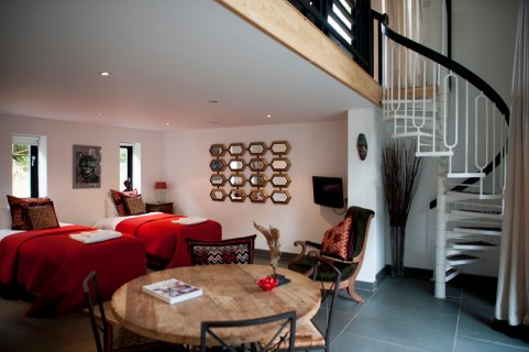 The Studio - The ground floor contains a king size bed that can be separated to make two single beds.