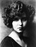 "Actress Clara Bow was born on July 29, 1905 in Brooklyn, NY. She starred in her first film by way of a beauty contest while still a teen. Later roles in projects like Black Oxen and Wine brought her considerable attention, and she had major success with the 1927 film It, which proved a tremendous box office draw and lent her the nickname the ""It"" Girl. After a number of scandals and a nervous breakdown, Bow retired from acting in 1933"