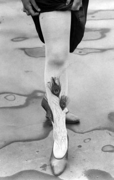 Feather decorated 1920s stockings - Decorating stockings with feathers and flowers was a common practice in the 1920s