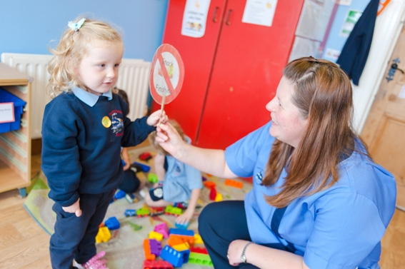 The Old Station Nursery, Dromore, Junior playgroup girl interacting with staff member