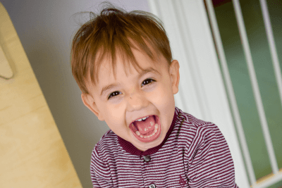 Toddler boy laughing out loud The Old Station Nursery in Dromore