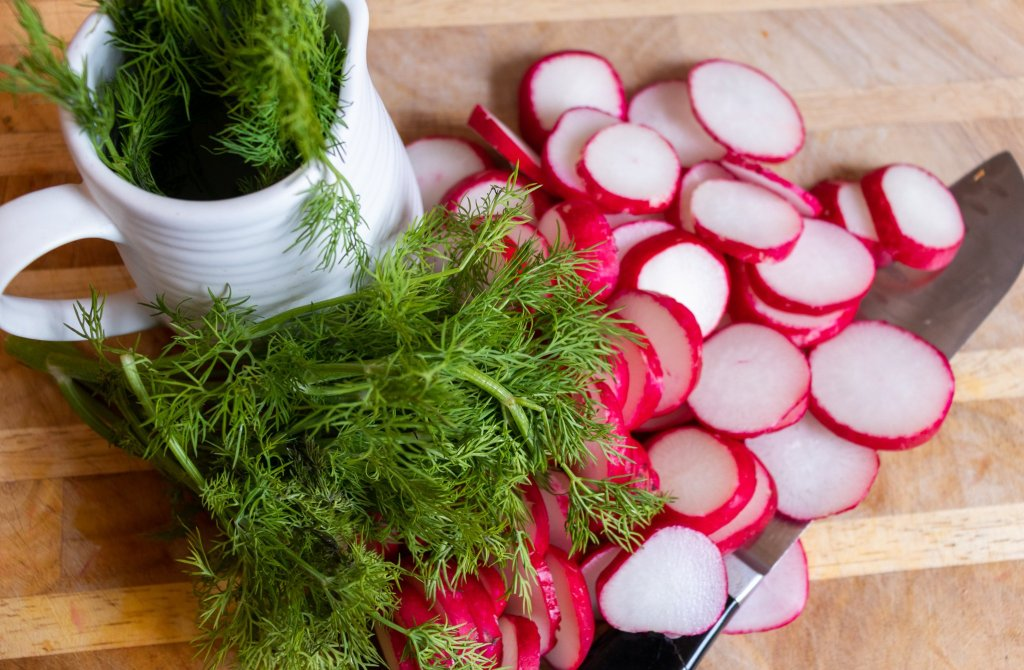 Sliced radishes and dill