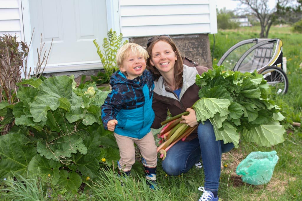 Mom and son holding rhubarb