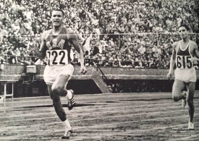 Billy Mills Crossing the finish line, from the boo,