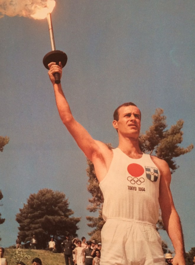 Greek hurdler, George Marcello, takes the first leg of the Torch Relay, from the book Tokyo Olympiad 1964, Kyodo News Agency.