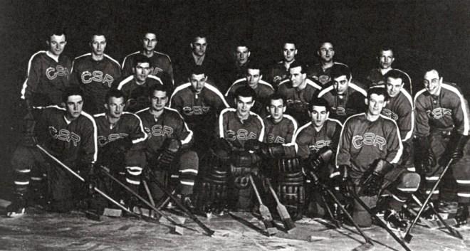 Czech goaltender, Vladimir Dvoracek, sits in the front row, fourth from the left.