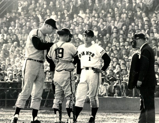 American pitcher Joe Stanka argues call with umpire after he thought he tossed strike to Giants Sadaharu Oh. The catcher is Katsuya Nomura, the Hawks triple crown champion.