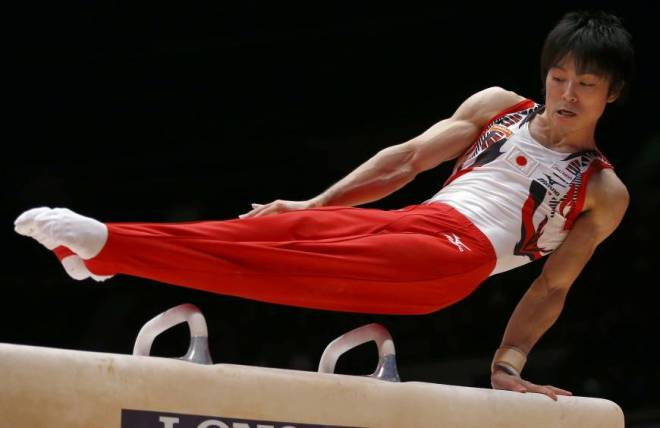 Kohei Uchimura performs on the pommel horse during the men's all-around final competition at the world championships in Glasgow, Scotland, on Friday. Uchimura won his sixth straight title in the event. | AP