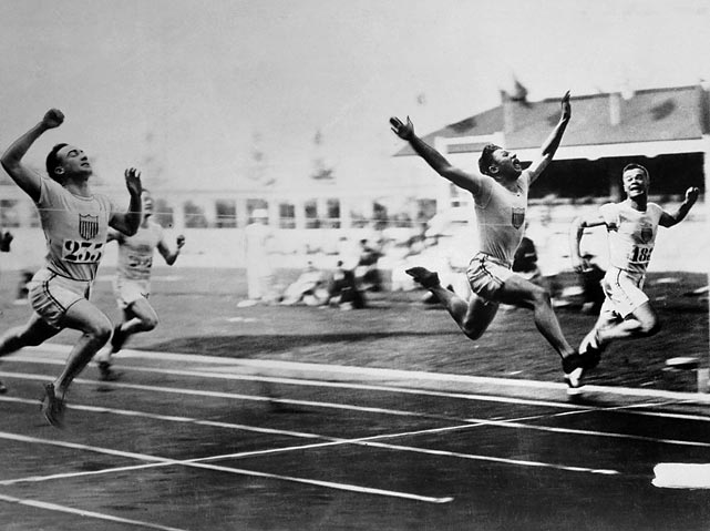 American, Charles Paddock, finishes in front of teammate Morris Kirksey (left) and Brit (Harry Edward) (right).
