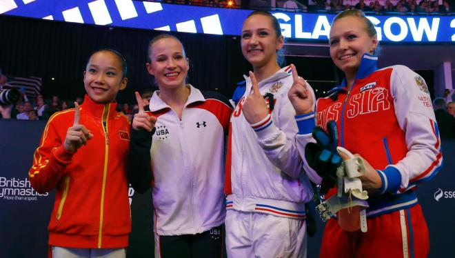 Four gold medal winners China's Fan Yilin, from left, Madison Kocian of the U.S., Russia's Viktoriia Komova and Russia's Daria Spiridonova pose after their uneven bars exercise at the women's apparatus final competition at the World Artistic Gymnastics championships at the SSE Hydro Arena in Glasgow, Scotland, Saturday, Oct. 31, 2015. (AP Photo/Matthias Schrader)