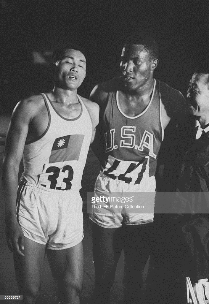 CK Yang and Rafer Johnson after 1500 meters