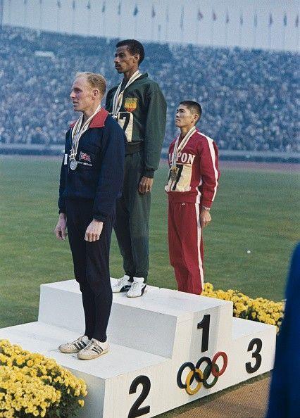 Heatley Bikila Tsuburaya on medal stand 1964