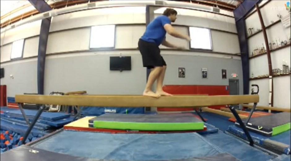 Man on balance beam