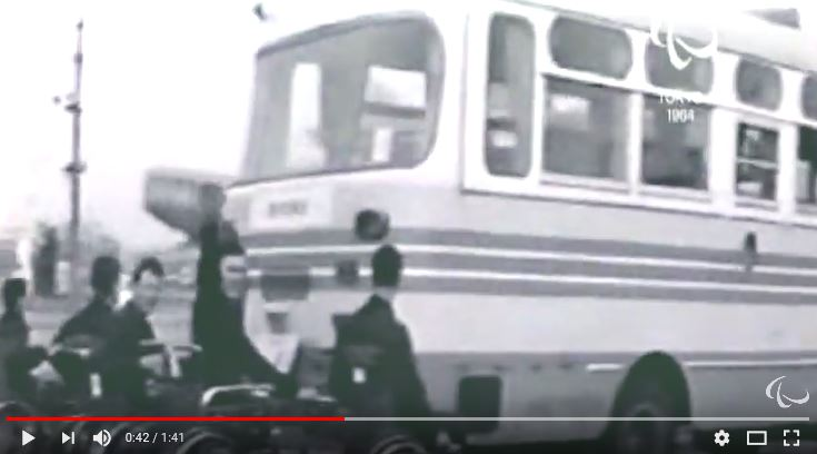 1964 Paralympics_youtube video of wheelchair holding onto bus