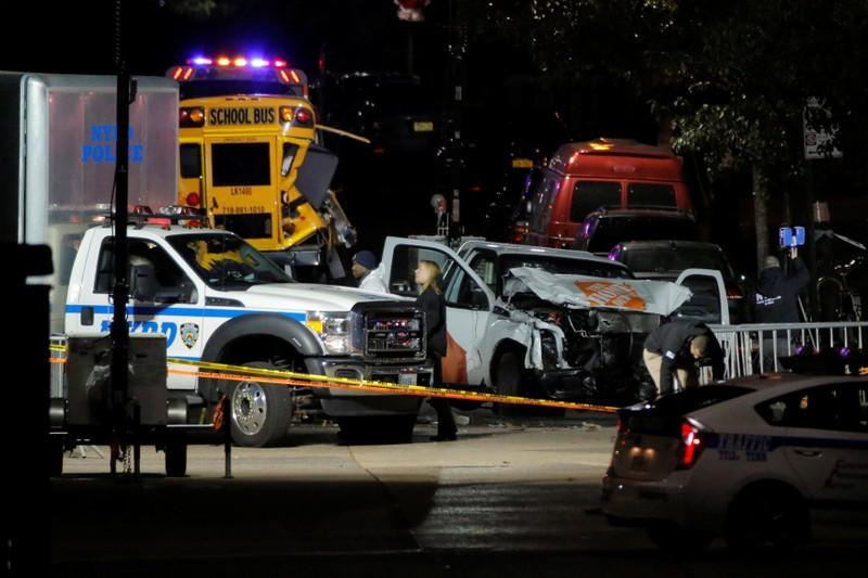 Police investigate a pickup truck used in an attack on the West Side Highway in Manhattan