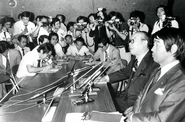 JOC head, Katsuji Shibata (seated, glasses) at press conference post-JOC vote to boycott