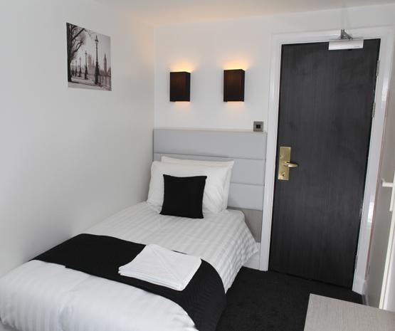 The Omega Hotel single bedroom