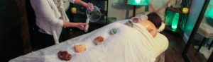 Sound healing and chakra crystals on a spa table