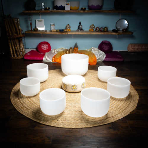 7 quartz crystal singing bowl chakra set with zafu at theom shoppe and spa sarasoa florida