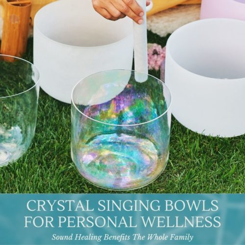 hand playing crystal singing bowls on grass saying crystal singing bowls for personal wellness class at the om shoppe and spa