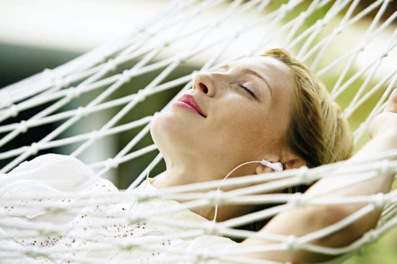 relaxing with headphones on hammock