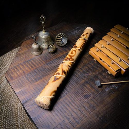 """Indonesian Rainstick 24"""" laying on table"""